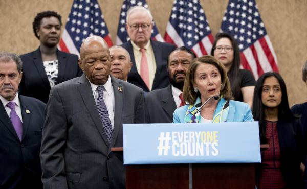 Nancy Pelosi of California (third from right), now House speaker, joins fellow Democrats, including Reps. José Serrano of New York and Elijah Cummings of Maryland, as well as other census advocates at a May 2018 press conference in Washington, D.C., abou