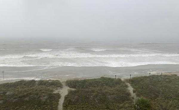 Hurricane Isaias made landfall in North Carolina, near the border with South Carolina, Monday night. Pictured is North Myrtle Beach, S.C., as bands of wind and rain hit the coast.