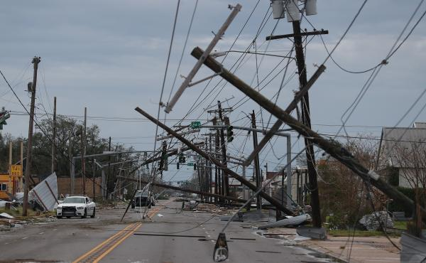 A street is seen strewn with debris and downed power lines after Hurricane Laura passed through Lake Charles, La., on Thursday.