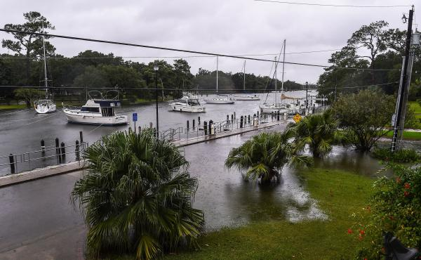 Water floods the road near a marina in Pascagoula, Miss., Tuesday, hours before Hurricane Sally is expected to make landfall on the Gulf Coast.