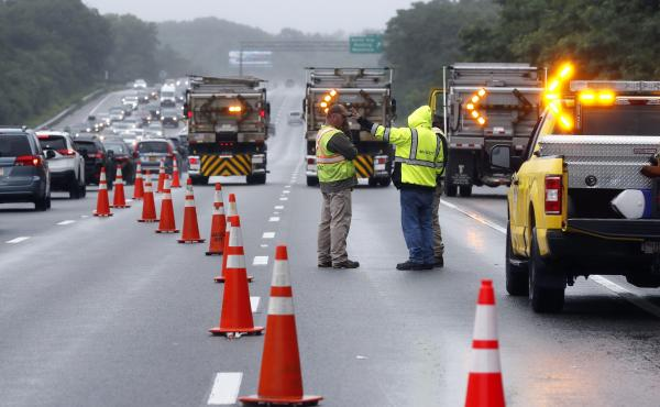Traffic on Interstate 95 was diverted for hours after a group of armed men fled from police near Wakefield, Mass. on Saturday. Massachusetts state police say 11 suspects have been taken into custody.