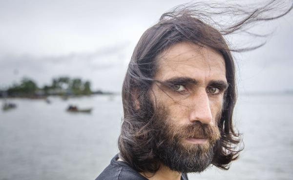 Behrouz Boochani, seen last year at the Australian detention center on Manus Island, Papua New Guinea, where the Kurdish-Iranian asylum-seeker spent years seeking his freedom. On Thursday, the prize-winning author touched down in New Zealand on his way to