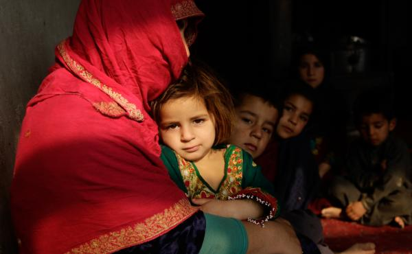Shaista sits in her tiny home on the outskirts of Kabul. Her youngest, a 3-year-old girl, sits on her lap; some of her other seven children sit beside her. Behind them, she is boiling a pot of water on the wood-burning stove. But she's told the children i
