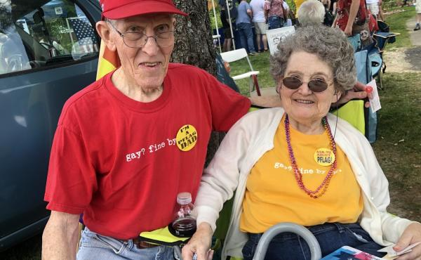 "Jerry Miller and his wife, Bea, at the picnic. The couple wears matching T-shirts that read ""Gay? Fine by me."""