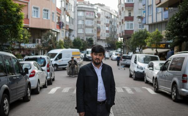 Uighur writer and poet Abdurehim Imin Parach stands in the Zeytinburnu neighborhood of Istanbul. He has been detained twice by Turkish authorities. NPR spoke to more than a dozen Uighurs in Istanbul who detailed how Turkish police arrested them and sent t