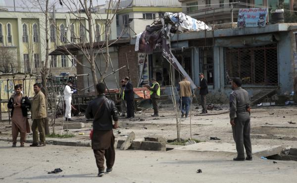 Security personnel inspec the site of a suicide attack in Kabul, on Friday.