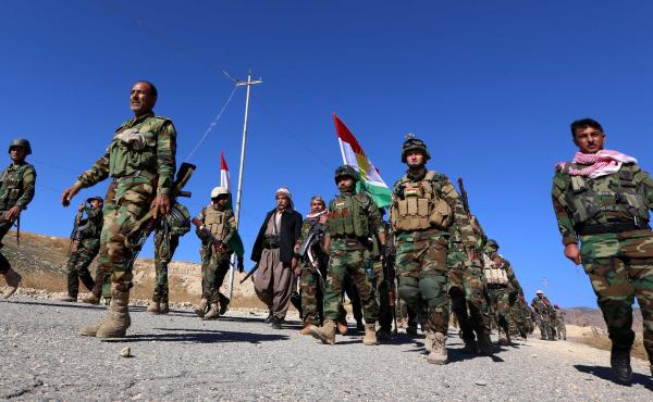 Kurdish peshmerga forces enter the northern Iraqi town of Sinjar on Friday after pushing out the Islamic State. The town is home to the Yazidi minority; many displaced members of the group say they are wary of returning home. They fear they could still be