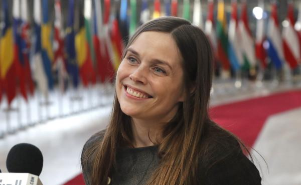 Iceland's Prime Minister Katrin Jakobsdottir speaks with the media as she arrives for an EU summit in Brussels in March.