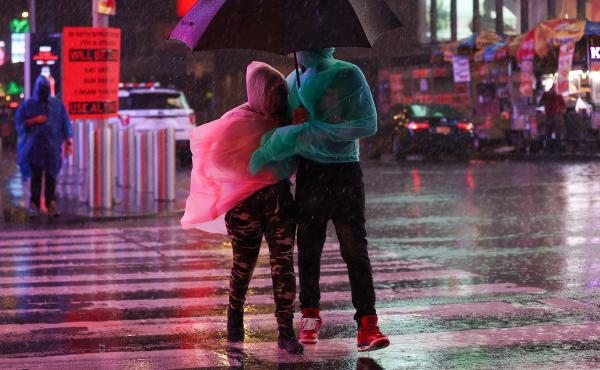 Heavy rainfall makes for a stormy Times Square outing Wednesday in New York City.