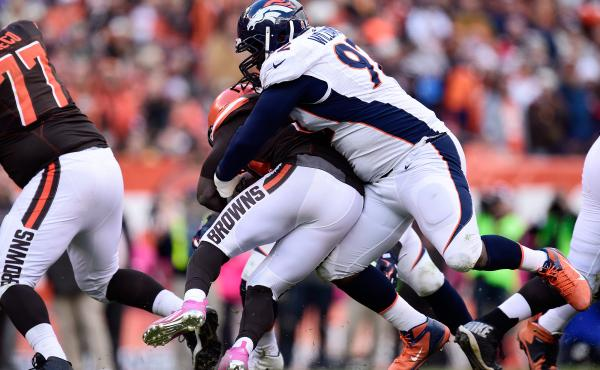 Sylvester Williams, a Denver Broncos nose guard, nabs Isaiah Crowell of the Cleveland Browns last October. If measured by BMI, Williams is obese.