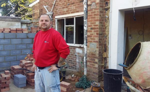 Krzystof Przadak, a Polish builder who has lived in Britain for 12 years, at a house he's renovating in London suburb. Przadak says he now earns 10 times what he did in Poland. But he's uncertain what will happen to him and other Poles in Britian if the U