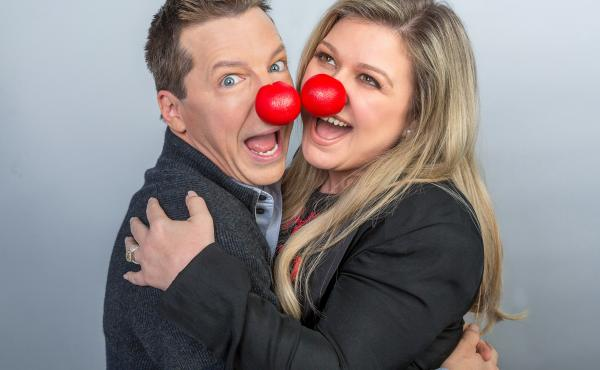 Sean Hayes and Kelly Clarkson wear red noses in support of Red Nose Day, a charity event that raises awareness for child poverty.