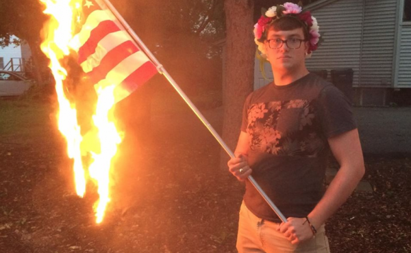 Bryton Mellott's photo of himself burning an American flag led to his arrest in Urbana, Ill. The local prosecutor says no charges will be filed against Mellott.