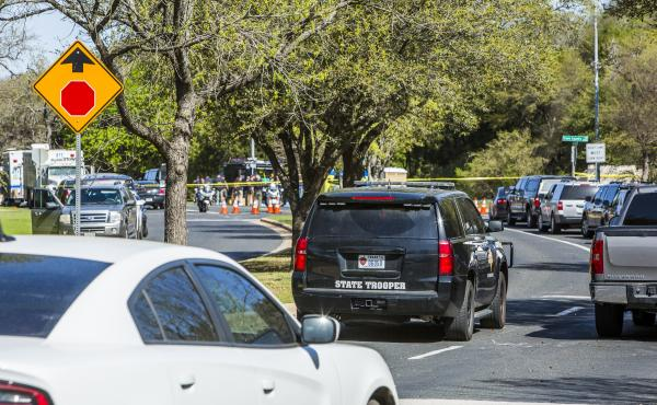 Police tape marks off a neighborhood in Austin, Texas, where a package bomb went off Sunday night, injuring two people.