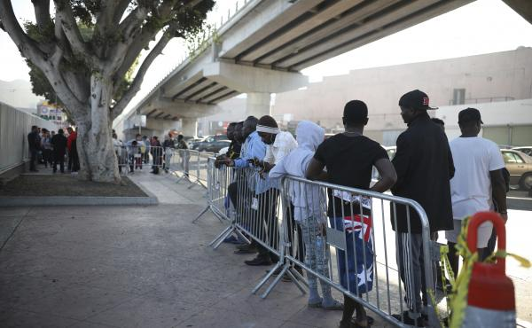 Migrants from Haiti, Africa, and Central America wait to see if their number will be called to cross the border and apply for asylum in the United States, at the El Chaparral border crossing in Tijuana, Mexico, Friday, Sept. 13, 2019.