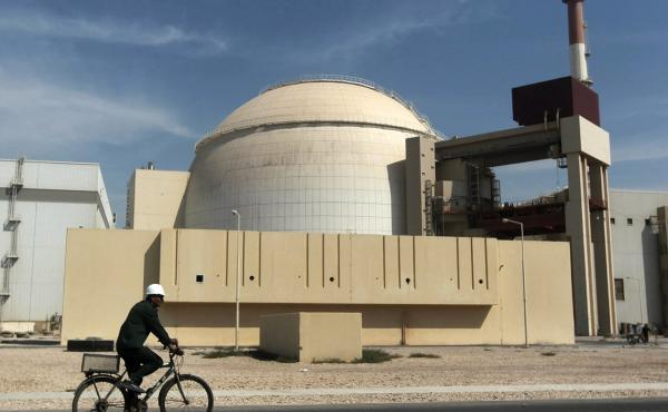 In this 2010 file photo, a worker rides a bicycle in front of the reactor building of the Bushehr nuclear power plant, just outside the southern city of Bushehr. Iran's sole nuclear power plant has undergone a temporary emergency shutdown, state TV report