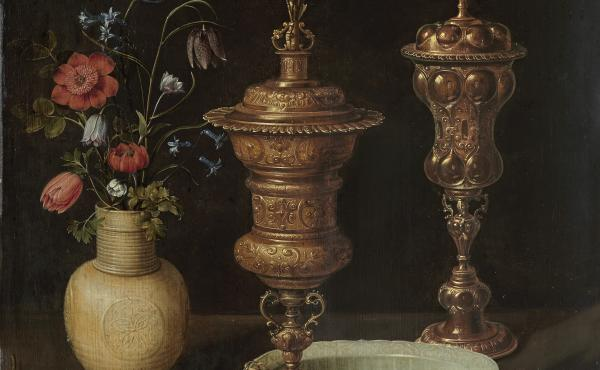 Still life with Flowers, Gilt Goblets, Coins and Shells was created by Clara Peeters in 1612. Peeters hid small self portraits in the goblet on the right.