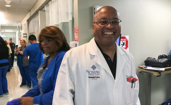 Dr. Winston Watkins, an internist at St. Joseph Medical Center in Houston, volunteered to do a shift in the ER to give his colleagues a break.