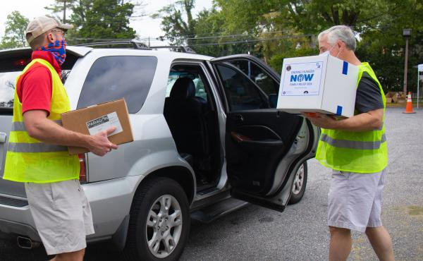 Volunteers from St. John's Episcopal Church in Bethesda help hand out food to a local resident at an event earlier this month.
