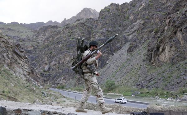 An Afghan soldier walks at a checkpoint last month on the outskirts of Kabul, Afghanistan.