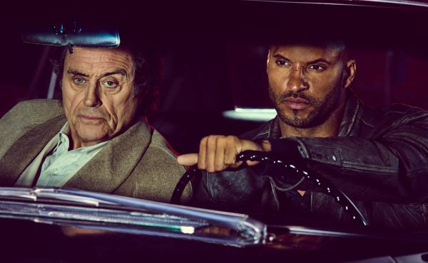 Ian McShane as Mr. Wednesday and Ricky Whittle as Shadow Moon hit the road in the new Starz adaptation of Neil Gaiman's American Gods.