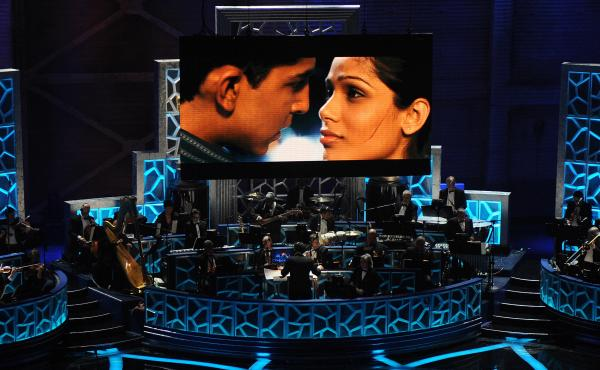 Musicians perform a song from Slumdog Millionaire during the 81st Annual Academy Awards on Feb. 22, 2009, in Hollywood, Calif. The film won 8 Oscars including Best Picture that year — and had box office returns to show for it.