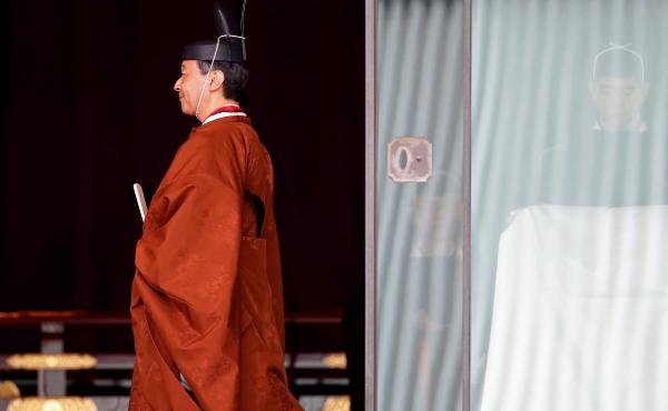 Japan's Emperor Naruhito leaves following a ceremony to proclaim his enthronement to the world at the Imperial Palace in Tokyo, on Tuesday.