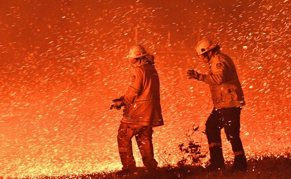 On December 31, 2019 firefighters struggled against the strong wind in an effort to secure nearby houses from bushfires near the town of Nowra in the Australian state of New South Wales.