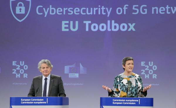 Two European Commission officials, Thierry Breton (left) and Margrethe Vestager (right), give a press conference on 5G security Wednesday in Brussels. The EU recommended that member states screen telecom firms, but did not call for banning any by name. Th