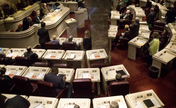 State representatives work in the house chambers at the State House in Montgomery, Ala. A federal appeals court sided with workers from Birmingham, Ala., who argued that state lawmakers racially discriminated against the majority-black city by blocking a