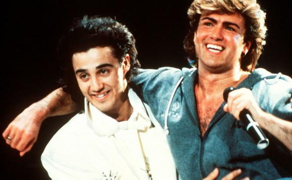 Andrew Ridgeley and George Michael of Wham performing on stage in 1985.