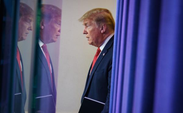 President Trump arrives for the coronavirus task force briefing at the White House on Thursday.