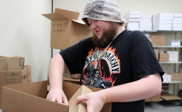 Michael Palone, 26, who has Asperger's syndrome and mild autism, is paid to assemble packages through a program run by The Arc in Union City, Calif. The program may close soon due to budget problems.