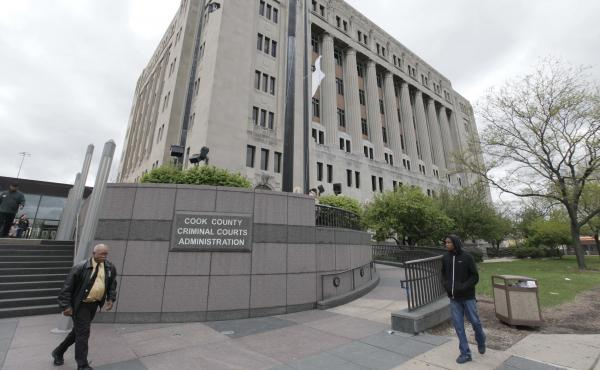 People walk past the Cook County Criminal Courts Building in April 2012. Public Defender Amy Campanelli wants sheriff's deputies to monitor the lockup areas to prevent men in custody from exposing themselves to female attorneys.
