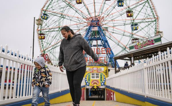 Visitors leave the Wonder Wheel ride after the re-opening of Coney Island's amusement parks on Friday.
