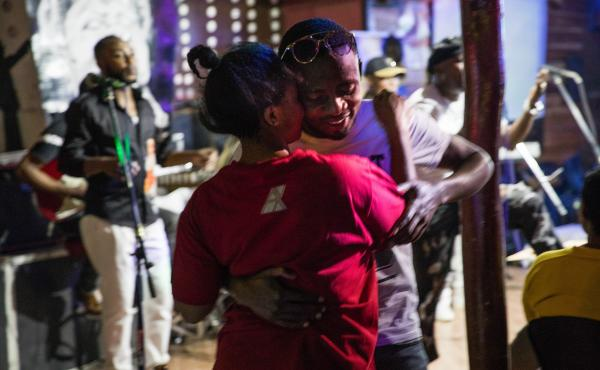 Despite the stress of Ebola, Media Joice Kashamba Emmanuela and her boyfriend, Espoir Kitumaini, dance to rumba music at Ibiza, a dance club in Goma, Democratic Republic of Congo.