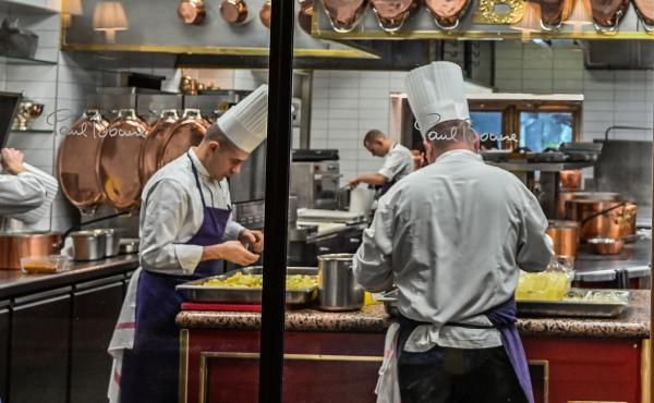 "Cooks work in the kitchen of the Paul Bocuse's restaurant ""L'auberge du Pont de Collonges"" on the eve of the official reopening after renovation works, on Jan. 23, in Collonges-au-Mont-d'Or near Lyon, southeastern France."