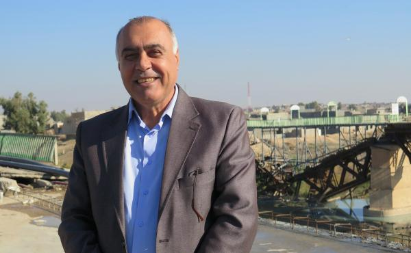 Yacoub Youssef, in charge of the small city of Jalawla in northern Iraq, stands on a bridge rebuilt by residents after it was blown up by ISIS. The city was heavily damaged and is in disputed territory – claimed by both the Iraqi and Kurdish governments