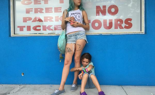 Actress Bria Vinaite plays 20-something single mom Halley in The Florida Project. Her daughter, Moonee, is played by Brooklynn Prince.