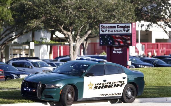 A Broward County Sheriff's Office vehicle is parked outside Marjory Stoneman Douglas High School, in Parkland, Fla.