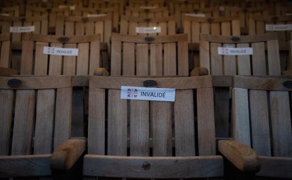 A photo shows seats with stickers to respect social distancing due to the COVID-19 pandemic, in the Theatre de l'Archeveche in Aix-en-Provence, southern France, on July 23, 2020.