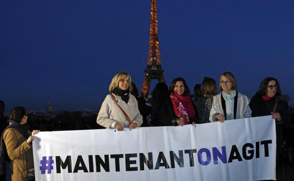 "French Culture Minister Françoise Nyssen (second right), Paris Mayor Anne Hidalgo (center) and women's rights activists hold a banner reading ""Maintenant on agit"" (""Now we act""), on the eve of International Women's Day on March 7. They aim to raise funds"