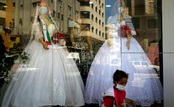 Mannequins dressed in wedding gowns and wearing protective face masks in Gaza City in March. With wedding halls closed and public gatherings forbidden to prevent the spread of the virus, many couples have celebrated their marriage in alleyways and apartme