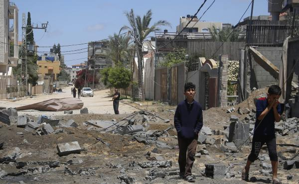 Palestinian children walk past the rubble of a house hit by Israeli airstrikes this week in Beit Lahyia in the northern Gaza Strip.