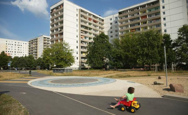 A child plays near communist-era apartment blocks in Hoyerswerda, Germany. After the collapse of the communist East German government that had redeveloped the area into an industrial hub, factories shut down and coal production declined. The population ha
