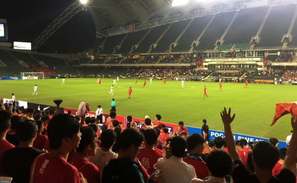 Fans cheer as Hong Kong's soccer team prepares to hit the field. Hong Kong fans have taken to booing China's national anthem in recent years to protest Beijing's tightening grip over the city. China's legislature has now made it illegal to disrespect the