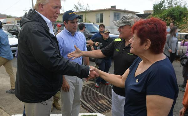 President Trump visits residents of Puerto Rico affected by Hurricane Maria on Oct. 3, 2017. The president has been criticized for not acting sympathetic enough for the plight on the island, questioning the death toll from that storm while the U.S. mainla