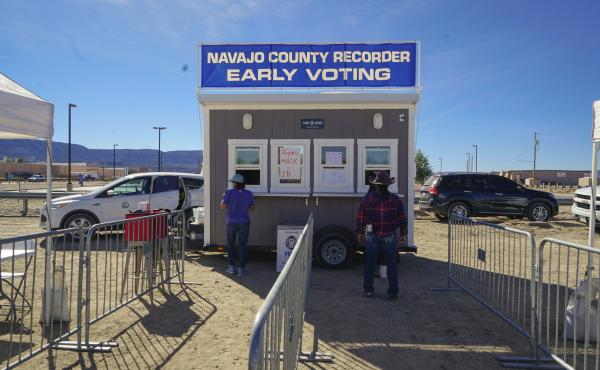 Navajo voters casting their ballots after riding 10 miles on horseback through Navajo County, Ariz.