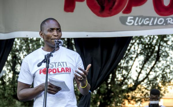 "Aboubakar Soumahoro speaks at a protest in Rome last month. ""If the workers lack dignity and rights, the food they provide is virtually rotten,"" he says in a new short documentary, The Invisibles."