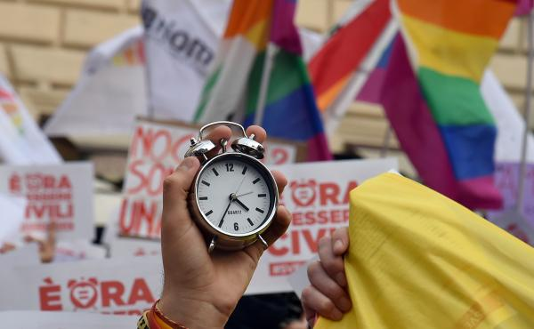 "Supporters of same-sex civil union hold alarm clocks ""to wake up Italia"" on January 23, near the Pantheon in central Rome. Italy is the only major Western European country not to have enacted legislation allowing gay couples to have their relationships le"